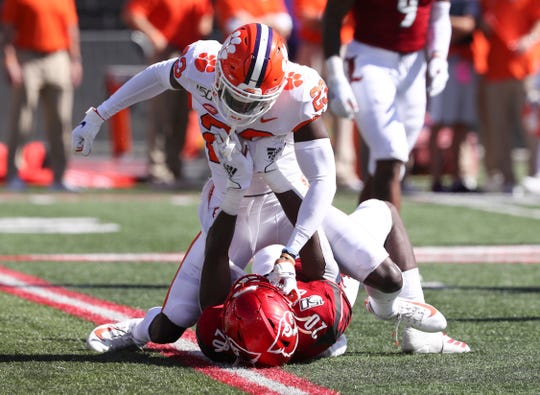 Clemson CB Andrew Booth Jr. (23) throws a punch at U of L DB Trennell Troutman (20) during a punt at Cardinal Stadium on Oct. 19, 2019 in Louisville, Ky.  Booth was ejected from the game.