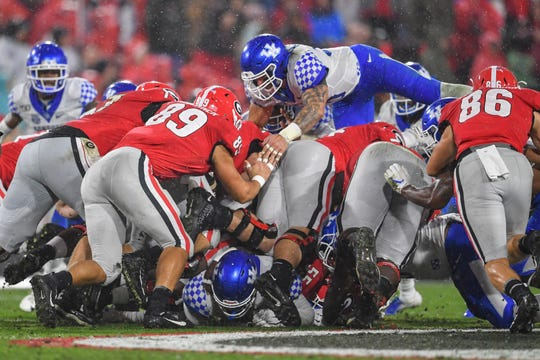 Georgia Bulldogs quarterback Jake Fromm (11) is stopped by the Kentucky Wildcats defense on a fourth down during the first half at Sanford Stadium in Athens, Georgia, on Saturday, Oct. 19, 2019.