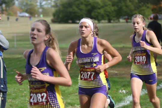 Lexington's Tessa Gerhardt bested her personal record by 21 seconds during the regional meet on Saturday helping Lady Lex claim their sixth consecutive regional title.