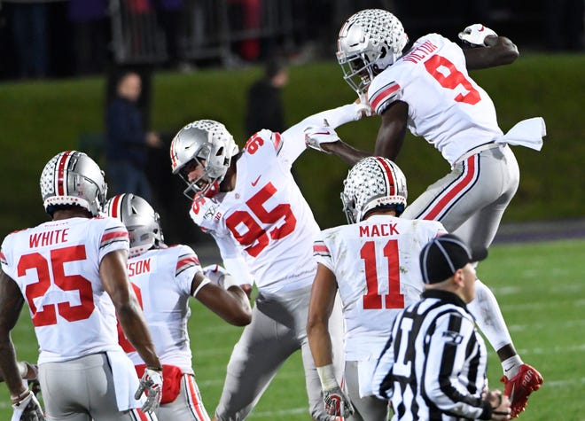Ohio State kicker Blake Haubeil (95) and his teammates celebrate his 55-yard field goal on the last play of the first half against Northwestern.