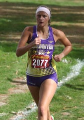 Lexington's Tessa Gerhardt bested her PR by 21 seconds when she ran a 19:19.5 to finish in 10th during the regional cross country meet netting Lady Lex their sixth consecutive regional title.
