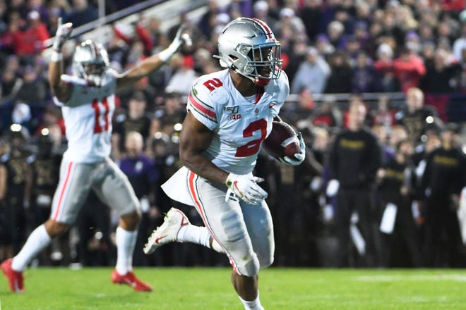 Ohio State tailback J.K. Dobbins runs for a 5-yard touchdown in the second quarter against Northwestern on Friday night.