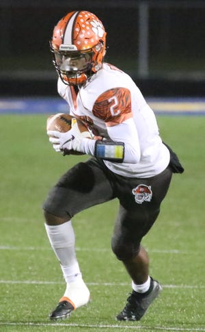 Mansfield Senior's Cyrus Ellerbe took the opening kickoff back for a touchdown during the Tygers' playoff-clinching win over Mount Vernon in Week 9.