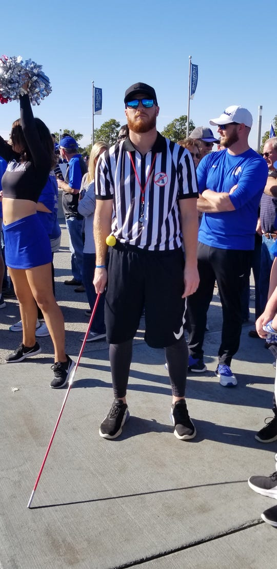 Memphis fan Ryan Marston dressed as a referee during tailgating prior to the Tigers game against Tulane Saturday
