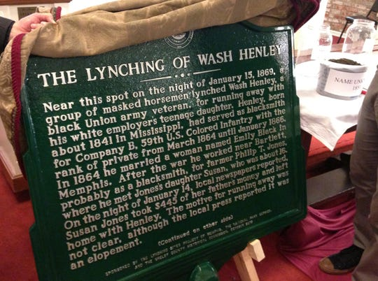 A historical marker commemorating the lynching of Wash Henley is unveiled at Collins Chapel Christian Methodist Episcopal Church in Memphis on Saturday, Oct. 19, 2019.