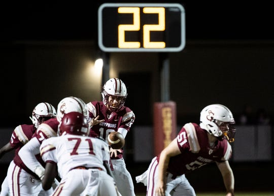 St. George's quarterback Wilson Whittemore (16) taking a snap during a home game against rival school Evangelical Christian Friday, Oct. 18,2019.
