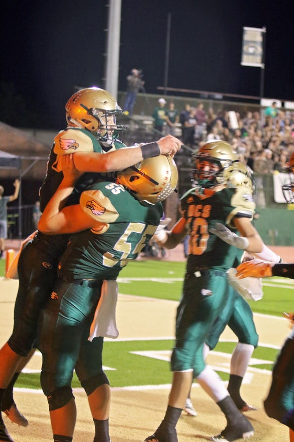OCS players celebrate a touchdown in Friday's 40-21 win over rival Oak Grove at Steven Fitzhugh Field at Eagles Stadium. The Eagles moved to fifth place in the latest LSWA Class 1A poll.