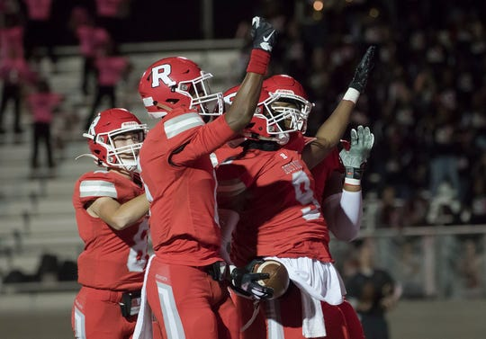 Ruston's Ketravion Hargrove (9), center, celebrates with teammates after scoring his second touchdown of the evening in the game against Ouachita at L.J. Garrett Stadium in Ruston, La. on Oct. 18.