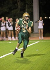 Quarterback Landon Graves (5) completed 16-of-23 attempts for 273 yards and two touchdowns in OCS' 40-21 win over rival Oak Grove.