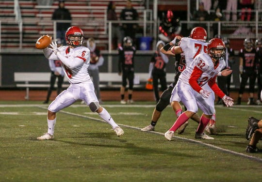 Parsippany's James Riedinger throws a pass during the first half of a football game Boonton High School on October 18, 2019.