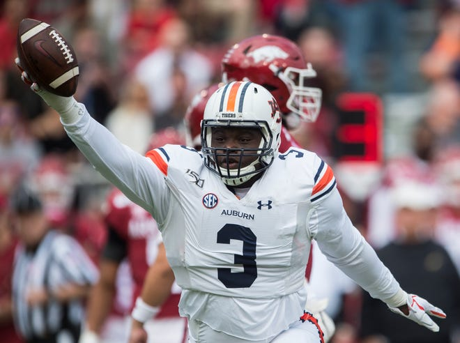 Auburn defensive lineman Marlon Davidson (3) celebrates after forcing and recovering a fumble at Donald W. Reynolds Razorback Stadium in Fayetteville, Ark., on Saturday, Oct. 19, 2019. Auburn leads Arkansas 17-0 at halftime.