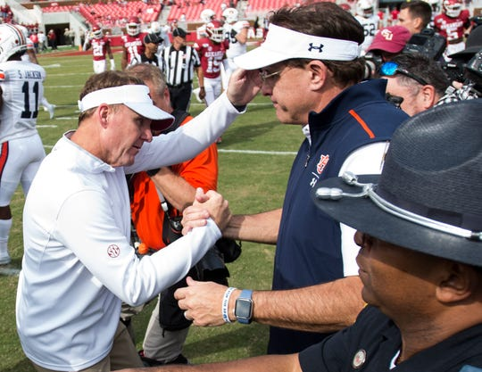 Arkansas head coach Chad Morris and Auburn head coach Gus Malzahn shake hands after the game at Donald W. Reynolds Razorback Stadium in Fayetteville, Ark., on Saturday, Oct. 19, 2019. Auburn defeated Arkansas 51-10.
