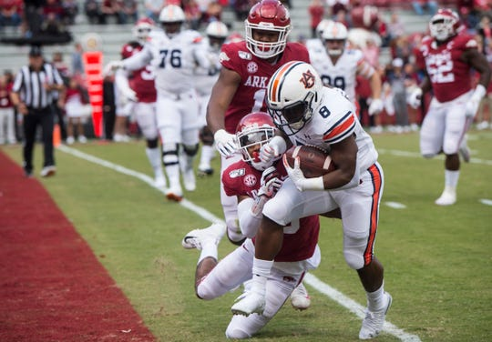 Auburn running back Shaun Shivers (8) forces his way into the end zone for a touchdown at Donald W. Reynolds Razorback Stadium in Fayetteville, Ark., on Saturday, Oct. 19, 2019.