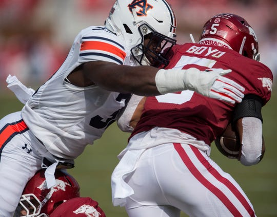Auburn linebacker K.J. Britt (33) tackles Arkansas running back Rakeem Boyd (5) at Donald W. Reynolds Razorback Stadium in Fayetteville, Ark., on Saturday, Oct. 19, 2019.