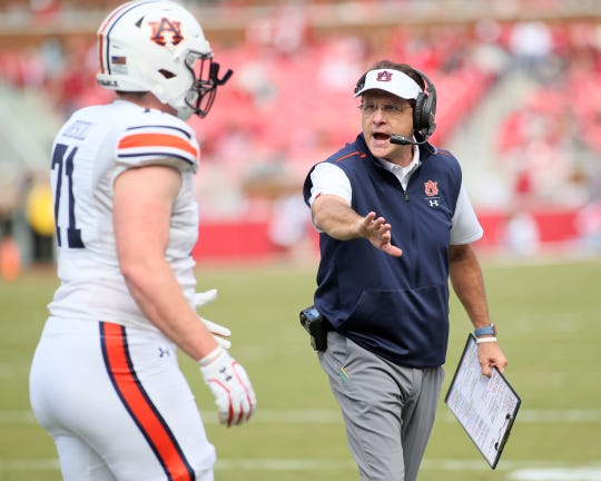 Oct 19, 2019; Fayetteville, AR, USA; Auburn Tigers head coach Gus Malzahn celebrates with offensive lineman Jack Driscoll (71) after a score in the first quarter against the Arkansas Razorbacks at Donald W. Reynolds Razorback Stadium. Mandatory Credit: Nelson Chenault-USA TODAY Sports