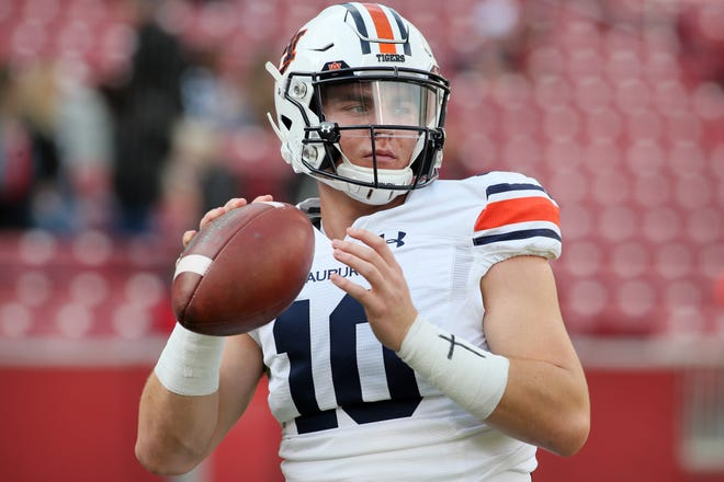 Oct 19, 2019; Fayetteville, AR, USA; Auburn Tigers quarterback Bo Nix (10) warms up prior to the game against the Arkansas Razorbacks at Donald W. Reynolds Razorback Stadium. Mandatory Credit: Nelson Chenault-USA TODAY Sports