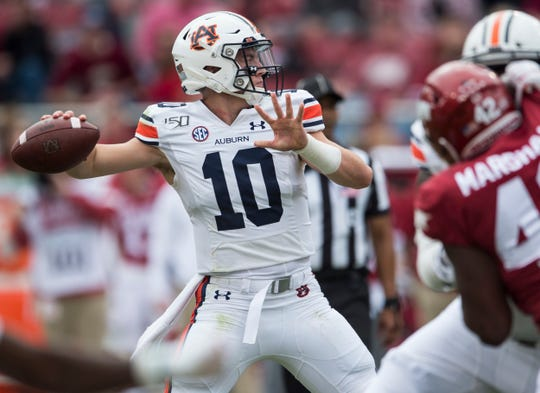 Auburn quarterback Bo Nix (10) throws the ball at Donald W. Reynolds Razorback Stadium in Fayetteville, Ark., on Saturday, Oct. 19, 2019. Auburn defeated Arkansas 51-10.