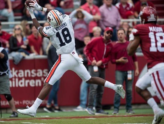 Auburn wide receiver Seth Williams (18) catches a long pass before scoring a touchdown at Donald W. Reynolds Razorback Stadium in Fayetteville, Ark., on Saturday, Oct. 19, 2019. Auburn defeated Arkansas 51-10.