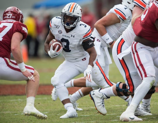 Auburn running back DJ Williams (3) runs the ball at Donald W. Reynolds Razorback Stadium in Fayetteville, Ark., on Saturday, Oct. 19, 2019. Auburn defeated Arkansas 51-10.