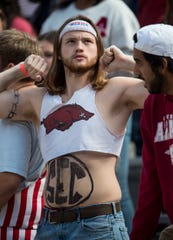 Arkansas's student section plays dress up for the game at Donald W. Reynolds Razorback Stadium in Fayetteville, Ark., on Saturday, Oct. 19, 2019. Auburn defeated Arkansas 51-10.