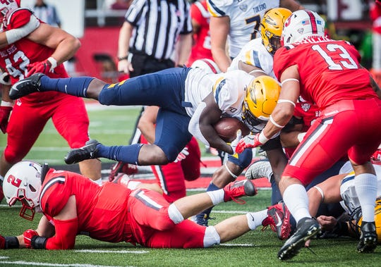 Ball State stops a run by Toledo during their Homecoming game at Scheumann Stadium Saturday, Oct. 19, 2019.