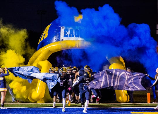 Delta players enter the field before their game against New Palestine Friday, Oct. 18, 2019.