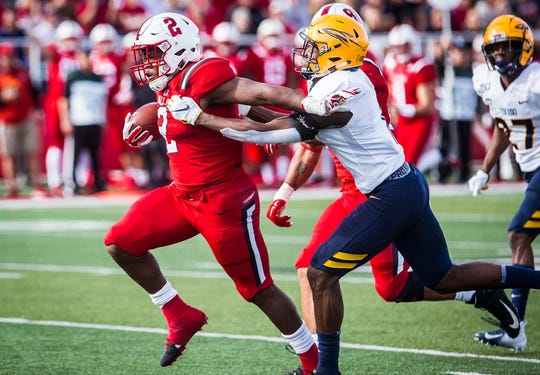 Ball State running back Caleb Huntley attempts to shed a Toledo defender during the Cardinals' game against the Rockets. BSU defeated Toledo in the Homecoming game on Oct. 19, 2019.