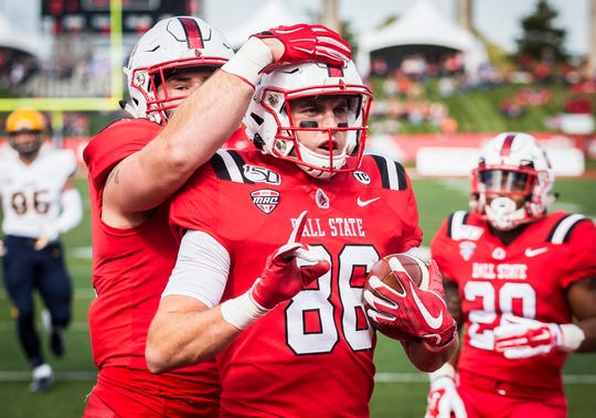 Ball State's Riley Miller celebrates with teammates after scoring a touchdown against Toledo during their Homecoming game at Scheumann Stadium Saturday, Oct. 19, 2019.