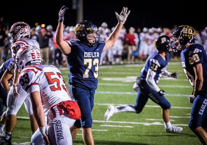 FILE -- Delta's Braxton Edwards celebrates a defensive stop during Delta's game against New Palestine at Delta High School Friday, Oct. 18, 2019.