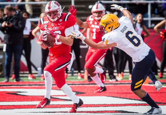 Ball State's Riley Miller catches a pass for a touchdown against Toledo's defense during their Homecoming game at Scheumann Stadium Saturday, Oct. 19, 2019.
