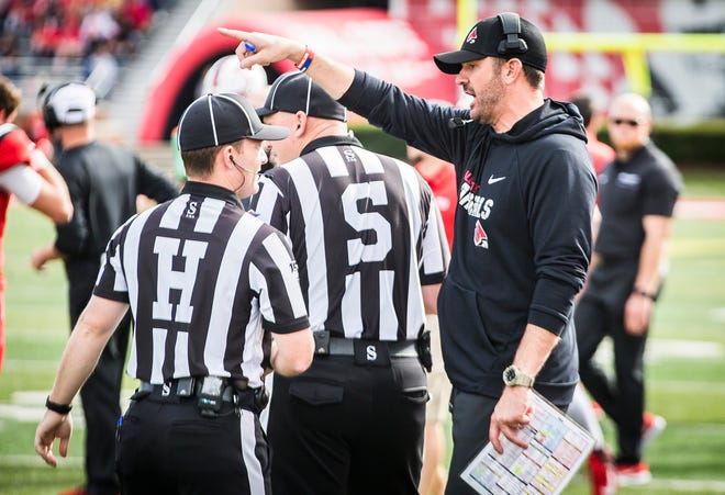 Head coach Mike Neu speaks with an official during Ball State's Homecoming game at Scheumann Stadium on Oct. 19, 2019.