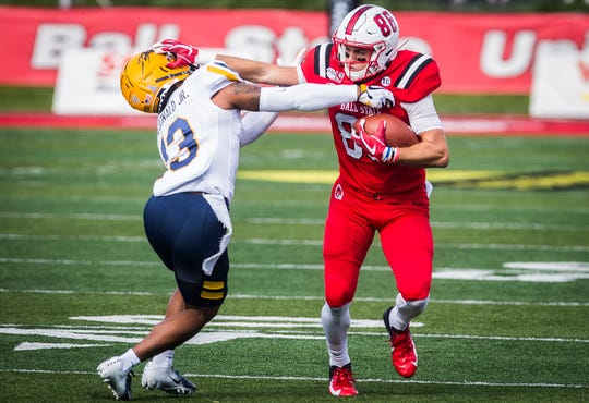 Ball State receiver Riley Miller attempts to get past a Toledo defender during the Cardinals' Homecoming victory against the Rockets on Oct. 19, 2019.