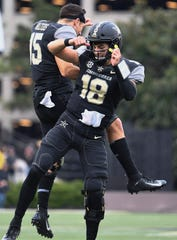 Vanderbilt Commodores quarterback Mo Hasan (18) celebrates a touchdown with Allen Walters (15) during the first quarter against Missouri Tigers at Vanderbilt Stadium Saturday, Oct. 19, 2019 in Nashville, Tenn.