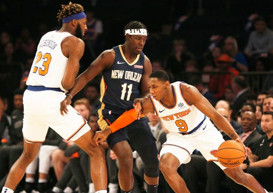 Oct 18, 2019; New York, NY, USA; New York Knicks forward RJ Barrett (9) dribbles the ball against New Orleans Pelicans guard Jrue Holiday (11) during the first half of a preseason game at Madison Square Garden. Mandatory Credit: Andy Marlin-USA TODAY Sports