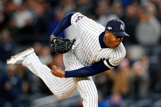 Oct 18, 2019; Bronx, NY, USA; New York Yankees relief pitcher Aroldis Chapman (54) pitches against the Houston Astros during the ninth inning of game five of the 2019 ALCS playoff baseball series at Yankee Stadium. The New York Yankees won 4-1.