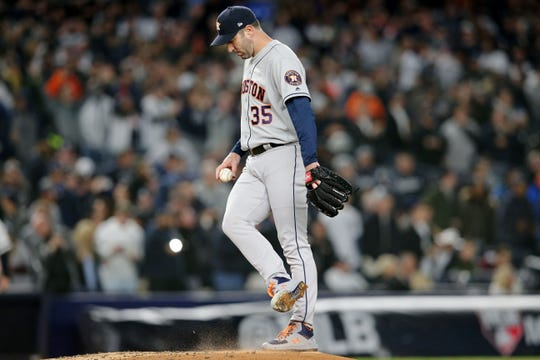 Oct 18, 2019; Bronx, NY, USA; Houston Astros starting pitcher Justin Verlander (35) reacts after a pitch against the New York Yankees during the first inning of game five of the 2019 ALCS playoff baseball series at Yankee Stadium.