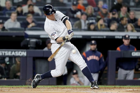 DJ LeMahieu #26 of the New York Yankees hits a a solo home run to right field against Justin Verlander #35 of the Houston Astros during the first inning in game five of the American League Championship Series at Yankee Stadium on October 18, 2019 in New York City.