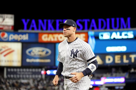 Oct 18, 2019; Bronx, NY, USA; New York Yankees right fielder Aaron Judge (99) walks to the dugout after warming up before game five of the 2019 ALCS playoff baseball series at Yankee Stadium.