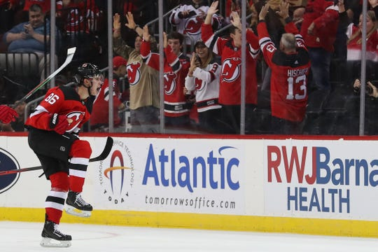 Oct 19, 2019; Newark, NJ, USA; New Jersey Devils center Jack Hughes (86) celebrates after scoring his first NHL goal during the first period of their game against the Vancouver Canucks at Prudential Center.
