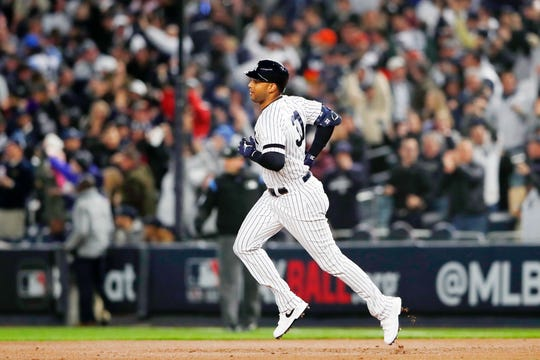 Oct 18, 2019; Bronx, NY, USA; New York Yankees center fielder Aaron Hicks (31) rounds the bases after hitting a three run home run against the Houston Astros during the first inning of game five of the 2019 ALCS playoff baseball series at Yankee Stadium.