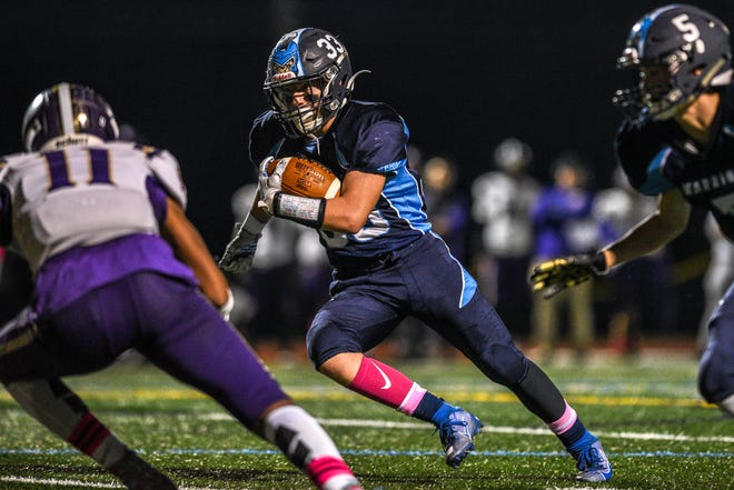 Garfield at Waldwick/Midland Park high school football game on Friday October 10, 2019. Waldwick #33 Zachary Hulsizer with the ball.