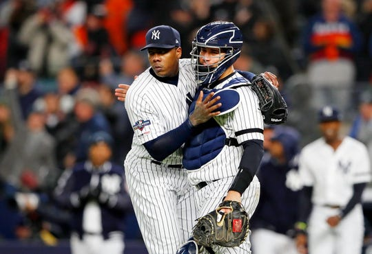 Oct 18, 2019; Bronx, NY, USA; New York Yankees relief pitcher Aroldis Chapman (left) and catcher Gary Sanchez (24) celebrate their win over the Houston Astros in game five of the 2019 ALCS playoff baseball series at Yankee Stadium. The New York Yankees won 4-1.