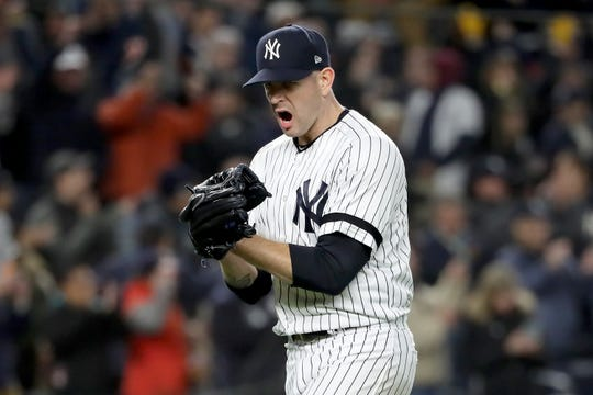 James Paxton #65 of the New York Yankees reacts after retiring the Houston Astros during the sixth inning in game five of the American League Championship Series at Yankee Stadium on October 18, 2019 in New York City.