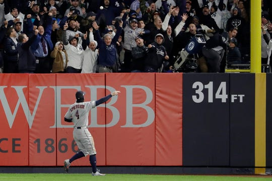 Houston Astros right fielder George Springer (4) motions as the ball, hit by New York Yankees' Aaron Hicks bounces off the foul pole for a three-run home run during the first inning of Game 5 of baseball's American League Championship Series, Friday, Oct. 18, 2019, in New York.