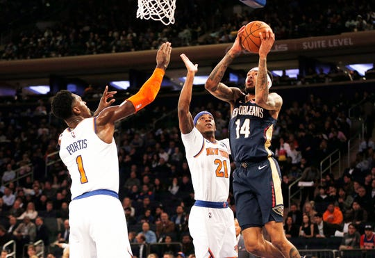 Oct 18, 2019; New York, NY, USA; New Orleans Pelicans forward Brandon Ingram (14) shoots defended by New York Knicks forward Bobby Portis (1) and center Mitchell Robinson (23) during the first half of a preseason game at Madison Square Garden. Mandatory Credit: Andy Marlin-USA TODAY Sports