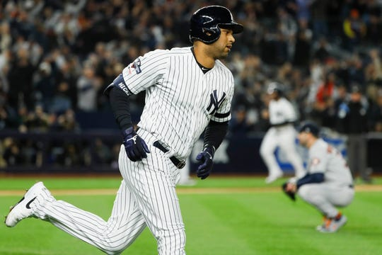 New York Yankees' Aaron Hicks rounds the bases after a three-run home run off Houston Astros starting pitcher Justin Verlander during the first inning in Game 5 of baseball's American League Championship Series Friday, Oct. 18, 2019, in New York.