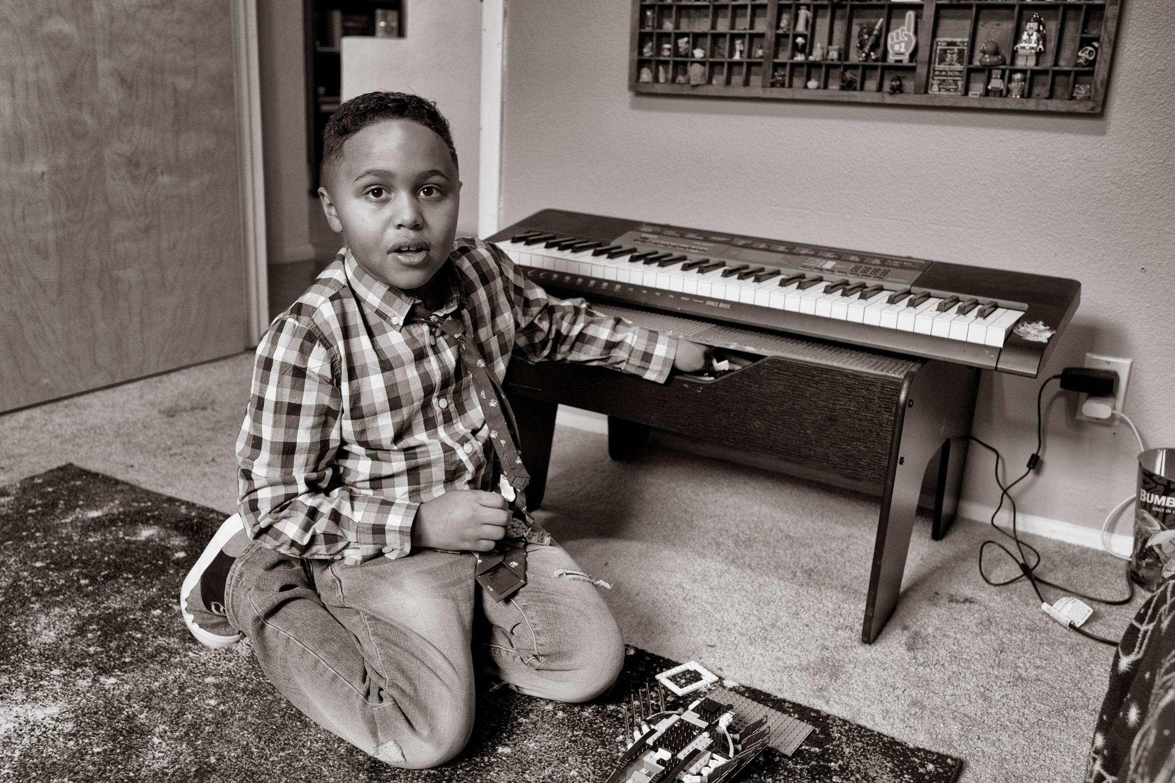 Jamari Nelson, 7,  displays part of his collection of Legos in his bedroom at home Albuquerque, New Mexico.