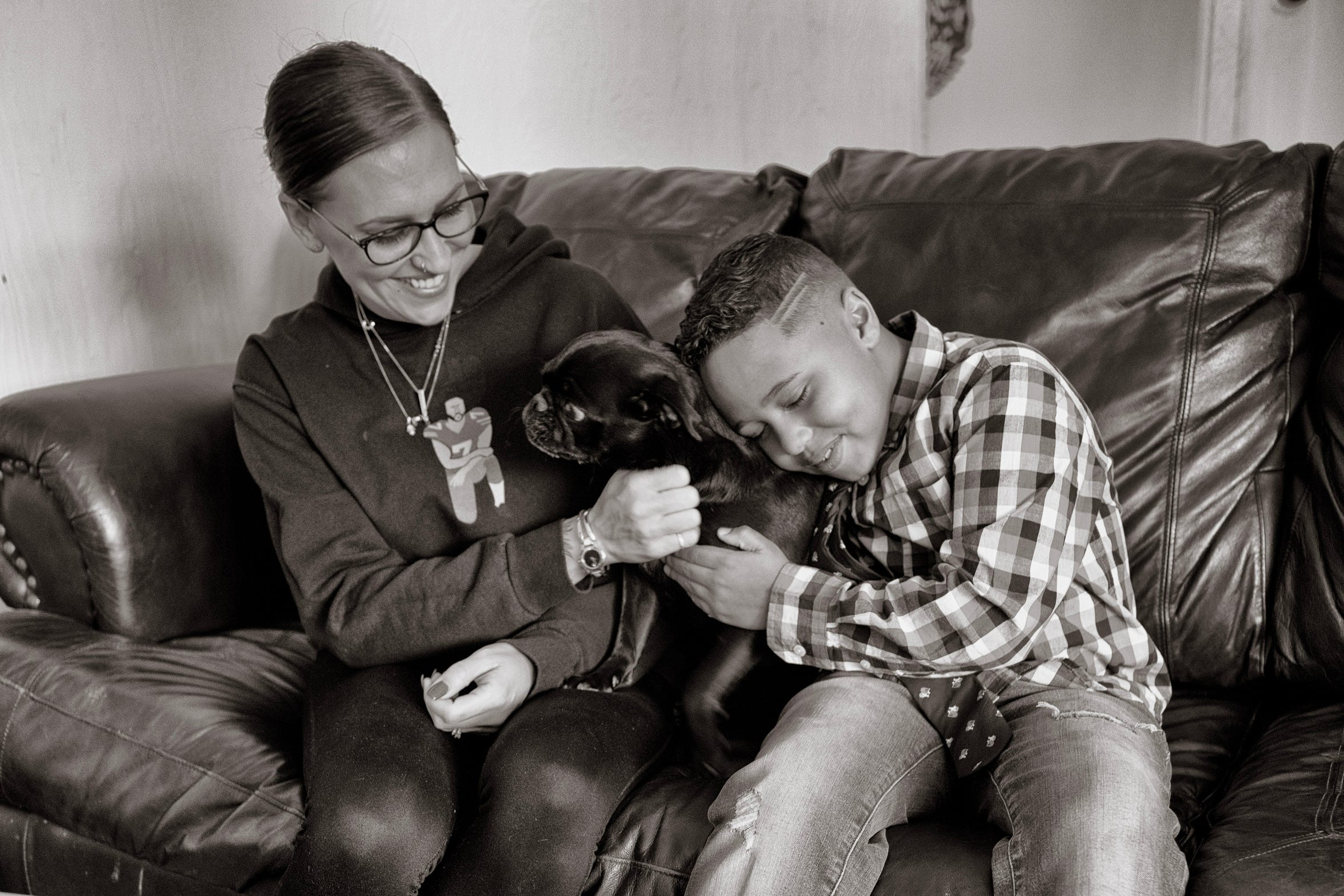 Jamari Nelson, 7, with his dog, Shadow, and his mom, Agatha Cooper. Jamari enjoys taking Shadow, a two-year-old pug, on walks through his neighborhood.