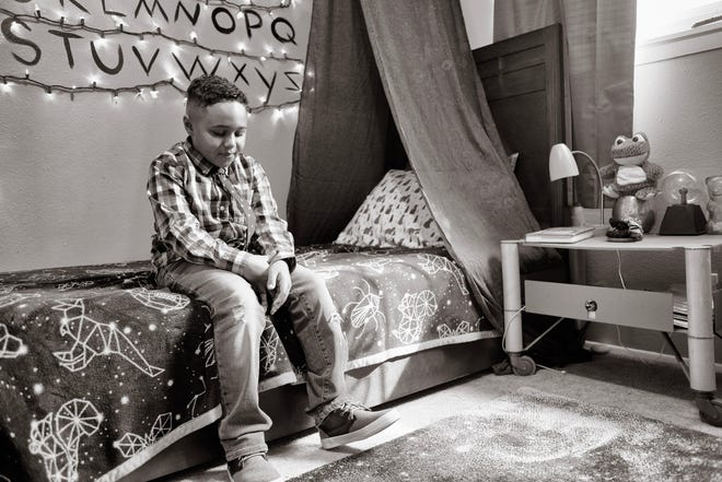 Jamari Nelson, 7, in his bedroom at home in Albuquerque, New Mexico.