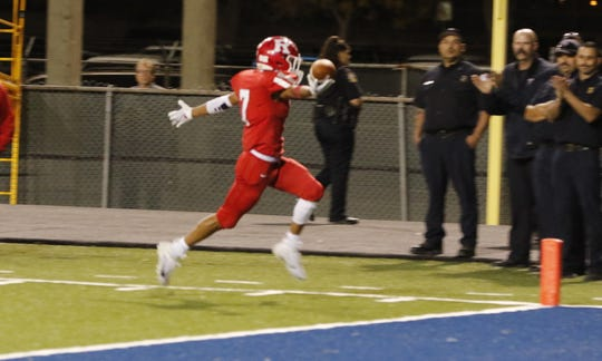 Roswell's Joel Renteria celebrates a touchdown scored in Friday's game against Artesia. Roswell won, 48-28.